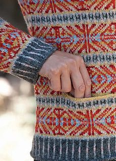 Effie is an elegant example of a contemporary Fair Isle Sweater. The vibrant, rich colors of Jamieson & Smith's pure wool 2-ply jumper yarn (there are more than eighty shades!) have been used on Shetland to knit traditional Fair Isle sweaters for decades. Here, a combination of thirteen shades, with brights working alongside softer, muted tones, give the ancient Shetland OXO pattern its distinctive classic look.