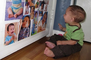 Babies love to look at babies, so I make a magazine collage of babies for baby and hang it on the back of their playroom door with contact paper.