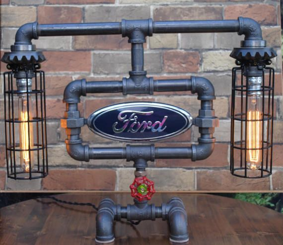 Industrial Pipe Lamp with gears and double sided Ford emblem. Constructed of almost new materials including 3/4 inch black Pipe, faucet valve, which doubles as the on off switch (always turn clockwise). Generous 8 foot twisted cloth covered cord with vintage look plug. Two 60 watt