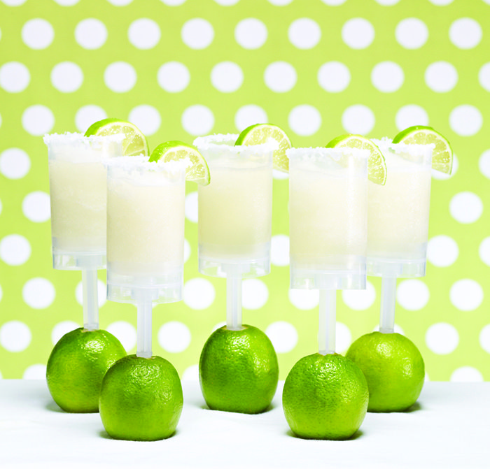 FROZEN LIME MARGARITA    PARTY TIP: Host a Mexican fiesta and greet guests at the door with these frozen lime margaritas, rimmed in salt! Try a variety of flavors by adding in frozen strawberries, mango, and other fruit.