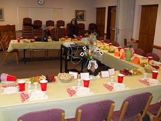 Relief Society Celebration - I especially like this table set up.  Click to see the table decorations for each decade of Relief Society, too.  Fun!