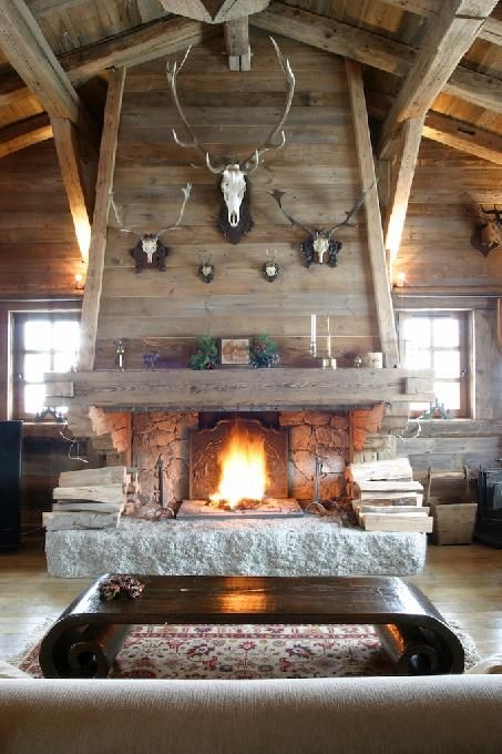 Alternative to chimney entirely of stone, which can impede the settlement of the logs.  ~Hugh Duncan