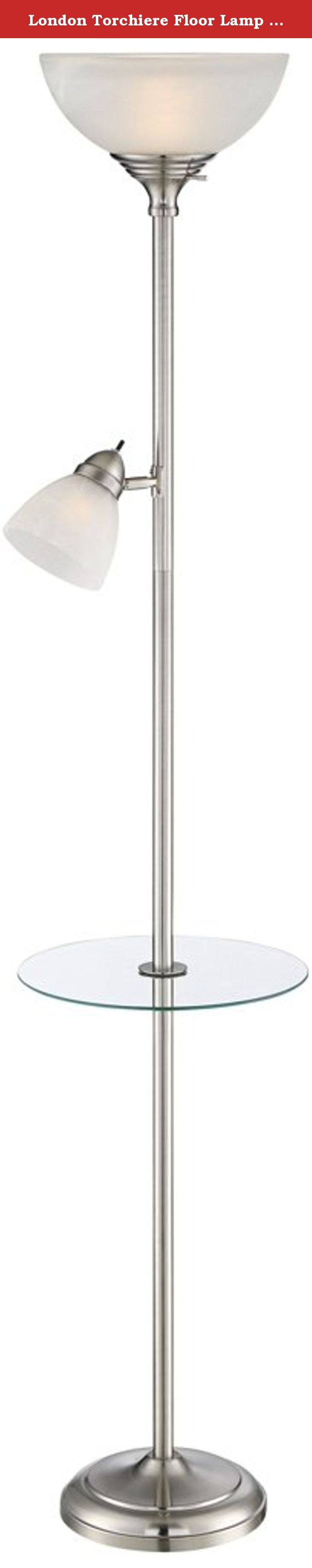 London Torchiere Floor Lamp with Table and Reading Light. The perfect choice next to an armchair, sofa or bedside, this metal torchiere floor lamp features an uplight as well as a side light. A clear tempered glass table is built into the column for utmost convenience. In a brushed nickel finish. - 2-light torchiere floor lamp with glass table. - Metal construction with brushed nickel finish. - Separate on/off switches on neck and lamp head. - Torchiere takes 150 watt bulb; side light…