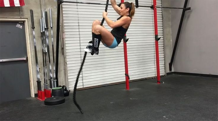 female crossfit athlete rope climb with fast J wrap