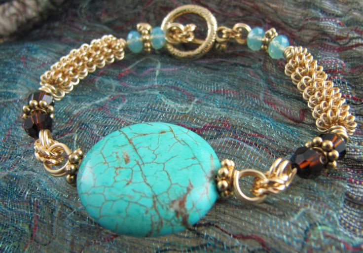 Wire coiled bracelet with magnesite center piece and Swarovski crystals.