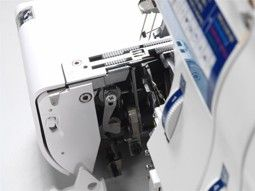 STITCH WIDTH FINGER LEVER No need to change plates when sewing a narrow or rolled hem. The lever controls whether the stitch width finger is retracted away from the needle plate or not. Flip the lever up or down without opening either the side or front cover. #elna #overlock #elna845