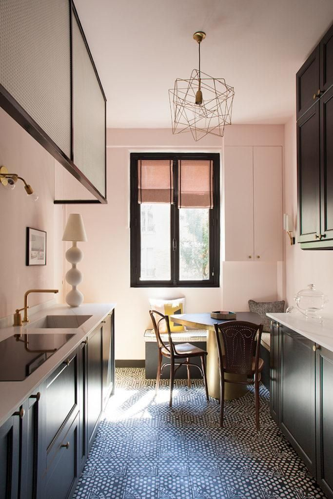 Light Pink Kitchen With Dark Cabinets And Modern Features