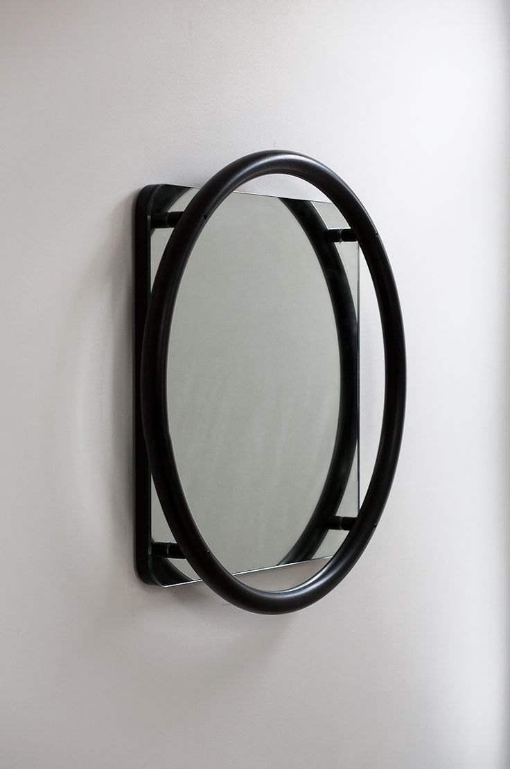 The Vima mirror stays true to the collection's form and language by keeping the thick and bold circular structure. The circular tube is attached onto the mirror with a 2 centimetre distance, and acts as a floating frame for the mirror.