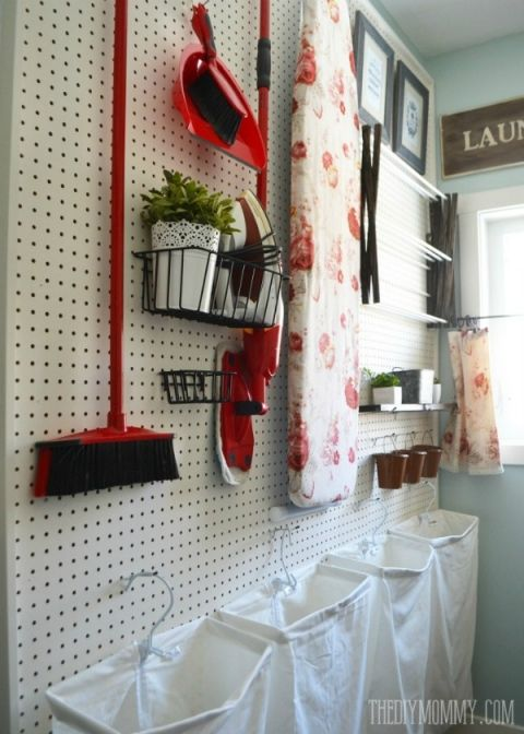 Laundry room peg board for clothing storage and cleaning supplies