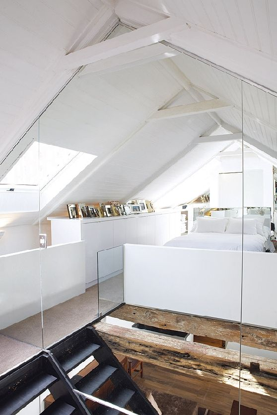 Clever use of massive mirrors to create space/depth to an otherwise small loft bedroom.