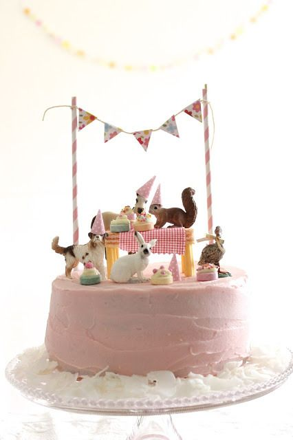 such an easy and cute cake decorating idea: stage a party with toy animals on top of your cake via Squeak and Squirrel