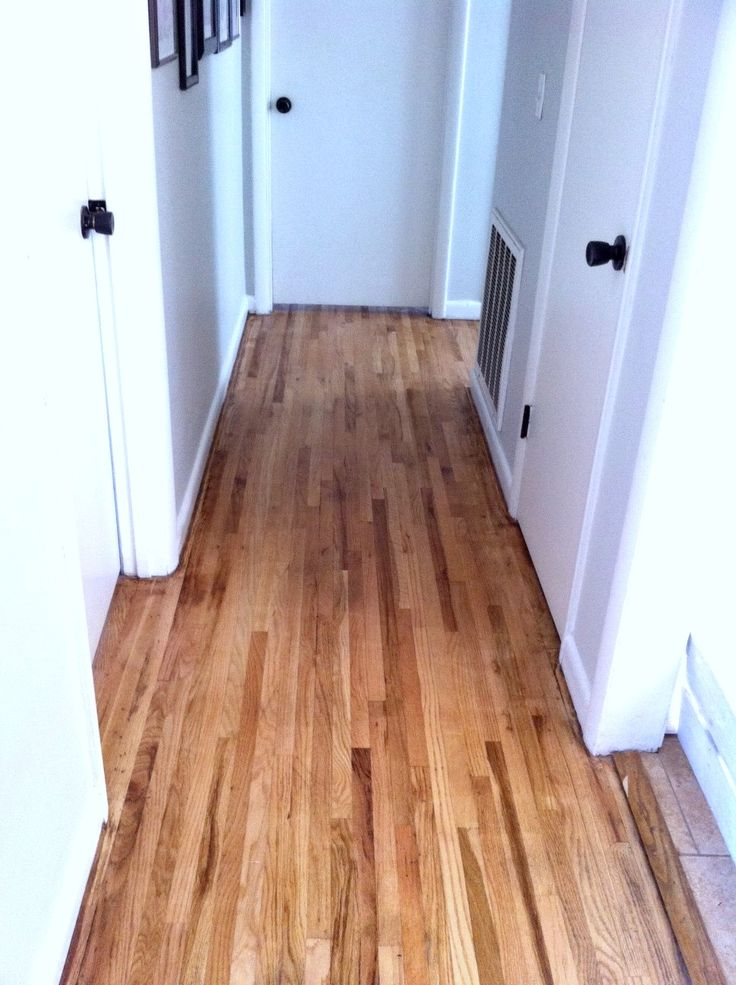 "Refinishing hardwood floors (includes price breakdown) |  Mom In Music City -- ""I didn't stain my floors. I think the natural wood goes well with our house. Dark wood is more formal, which our house isn't."""