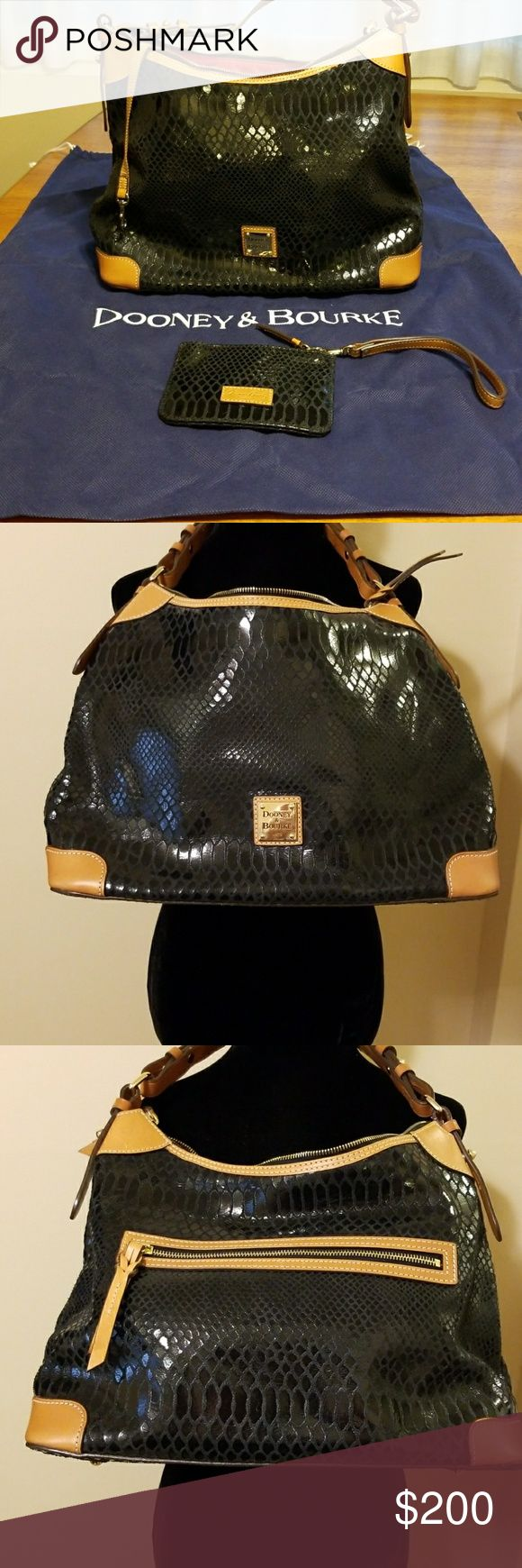 "NWOT Dooney&Bourke snakeskin leather shoulder bag This gorgeous black snakeskin bag with natural leather trim is in perfect condition. It comes with the Dooney & Bourke dust bag and a matching black snakeskin wristlet. The outside has a zipper pocket and the interior has 2 slip pockets and a zipper pocket. There is also a middle zipper section that divides the interior and a key-keeper strap. 9"" strap drop. 10""x14""x6"". Gold hardware, top zip closure, footed bottom. Dooney & Bourke Bags…"
