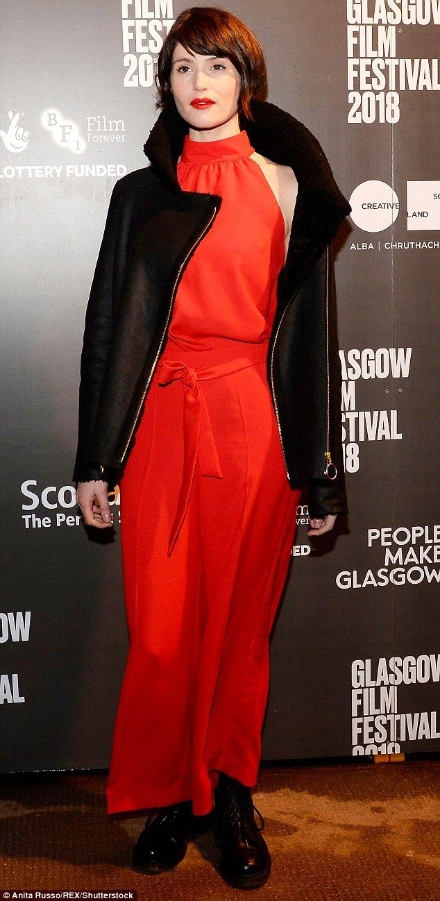 Gemma Arterton was a vision in red as she stepped out into the cold Scottish night in a bold red jumpsuit and Doc Martins for the premiere of her new film The Escape at the Glasgow Film Festival.