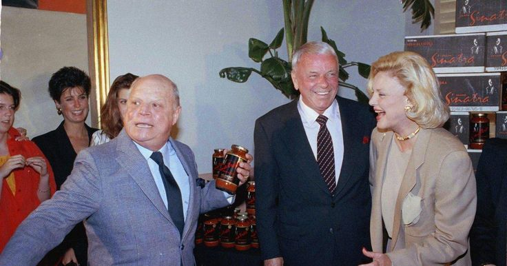 Frank and Barbara Sinatra with Don Rickles. Don is holding a jar of Sinatra's pasta sauce.