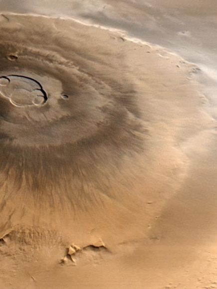 Olympus Mons, an extinct shield volcano on Mars. At three times the height of Mount Everest, it is the tallest mountain in our solar system.