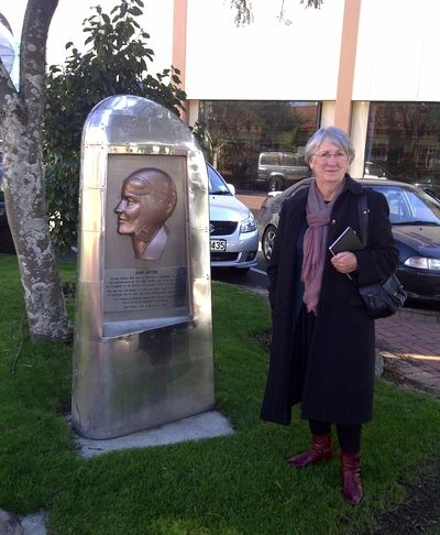 Dame Fiona Kidman stands next to the Jean Batten memorial, Rotorua.  Dame Fiona was in Rotorua to award the prizes of the winning entries of the Rotorua District Library's Short Story Competition also judged by her.