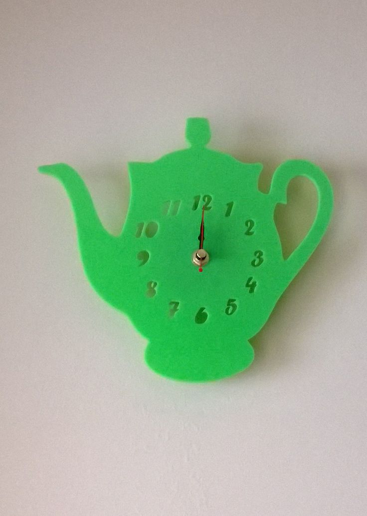 Lime green 'Tipsy The Teapot' clock would look great in a kitchen or dinning room.  Designed and created in Pembrokeshire, South West Wales!