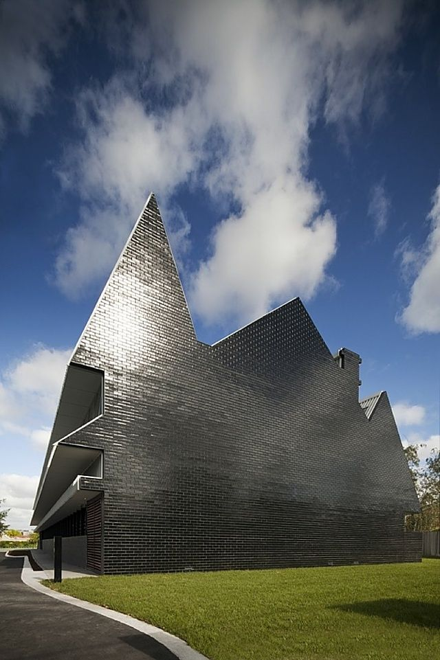 The Two Storey School Building Is Faced In Glossy Black Tiles And Was  Designed By Australian Architects McBride Charles Ryan.