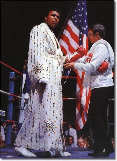 Muhammad Ali wearing the robe given by Elvis. March 31, 1974