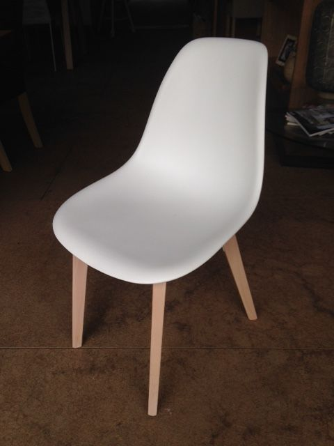 The white bucket dining chair for sale at Wildflower Furniture
