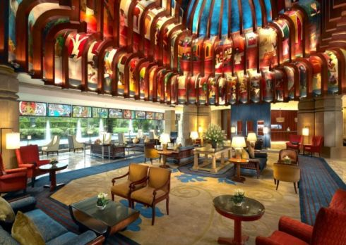 The stunning lobby at ITC Maurya, New Delhi, which celebrates India's golden age of art and design with a 3,000 sq ft mural depicting the procession of life. Various other iconic artworks can be found throughout the hotel.