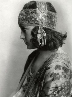 Gloria Swanson, 1920. headpeices in fine lace and silk with soft flowing pattens and tassels