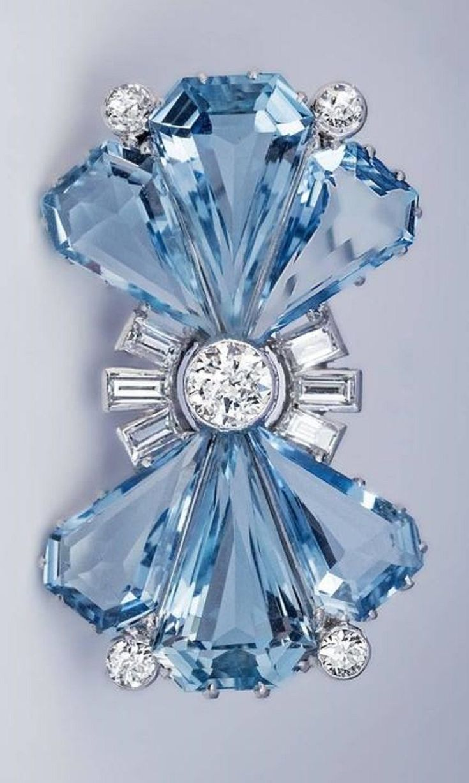 An Art Deco platinum, aquamarine and diamond bow brooch, circa 1935.