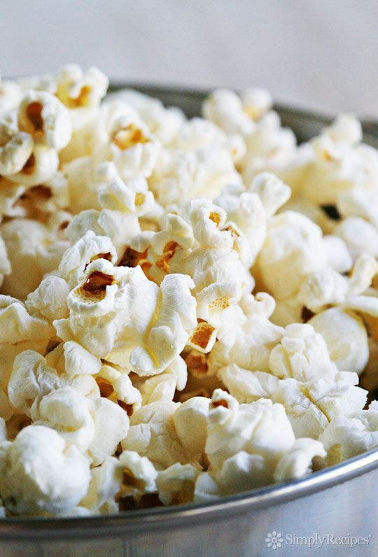Learn how to make PERFECT popcorn on the stovetop. No burnt kernels! Easy stove-top popcorn recipe on SimplyRecipes.com