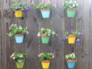 pots on fence....Buy these great clips at www.hangapot.com