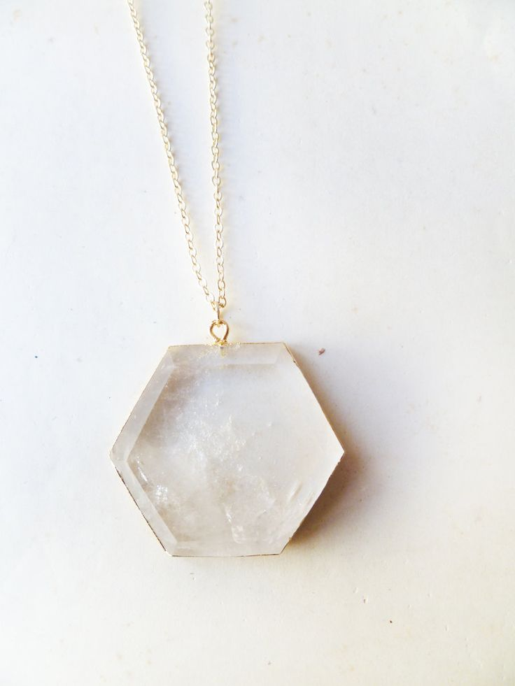 T E S L A - natural crystal quartz geometric hexagon pendant edged in gold. $40.00, via Etsy.