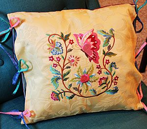 Free project instructions to make an embroidered tie-on pillow sham.