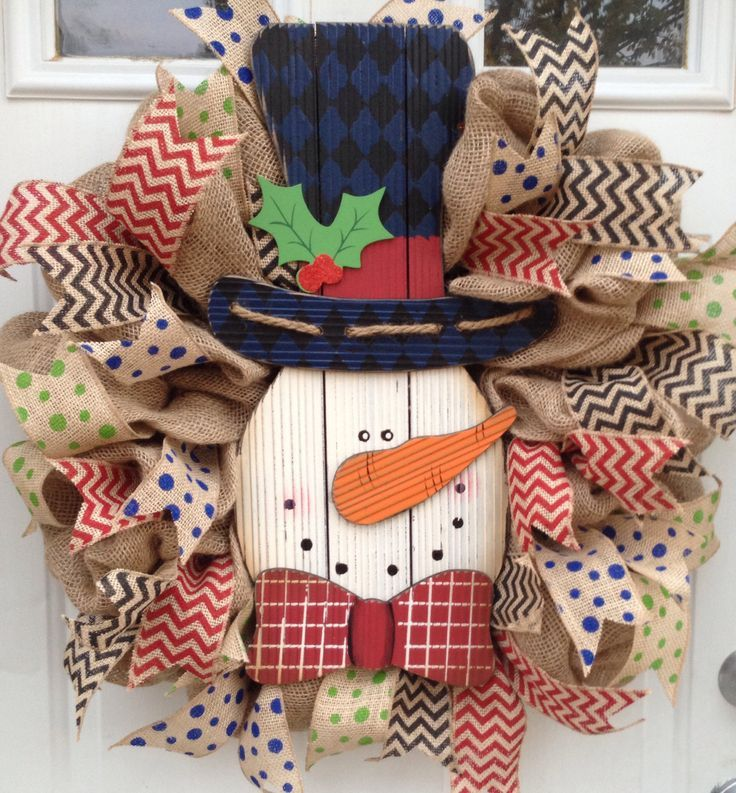 Burlap Christmas wreath!! I'd probably use something other than a snowman but love this!