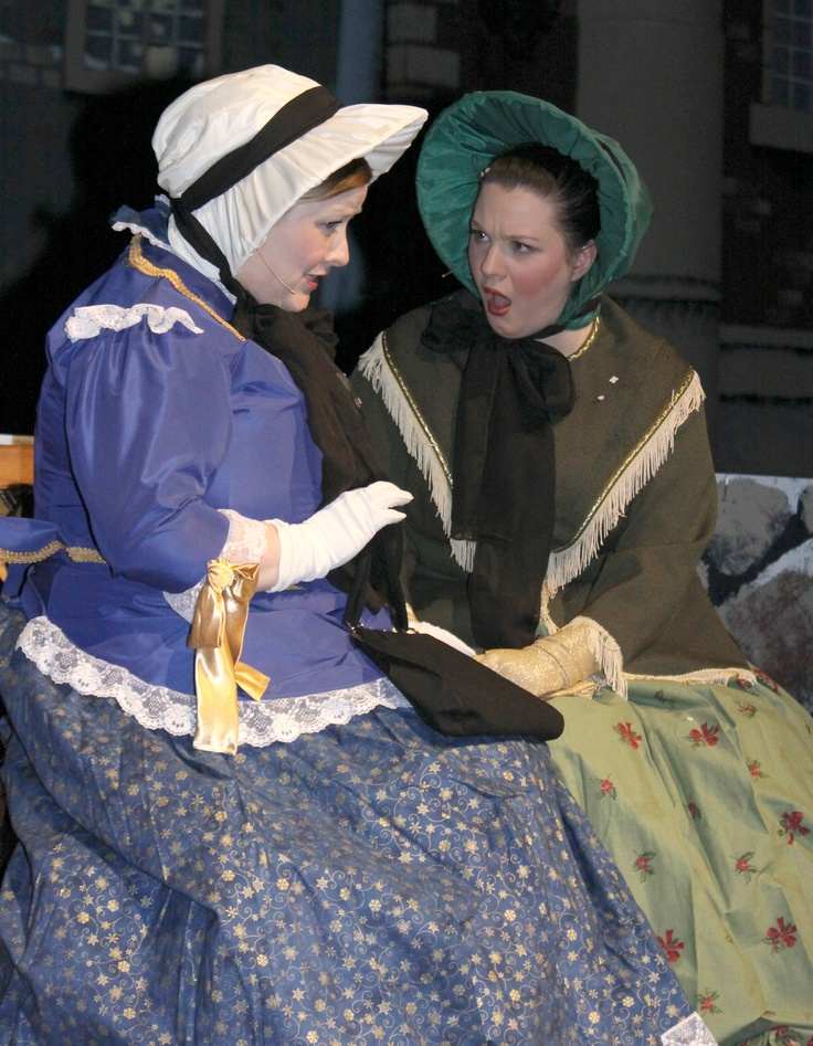 Narrators Rachelle Nelson and Abigail Kokura seem to be astounded at what Scrooge did during the Briercrest College and Seminary performance of A Christmas Carol by Charles Dickens. - Photo by Fiona Graham
