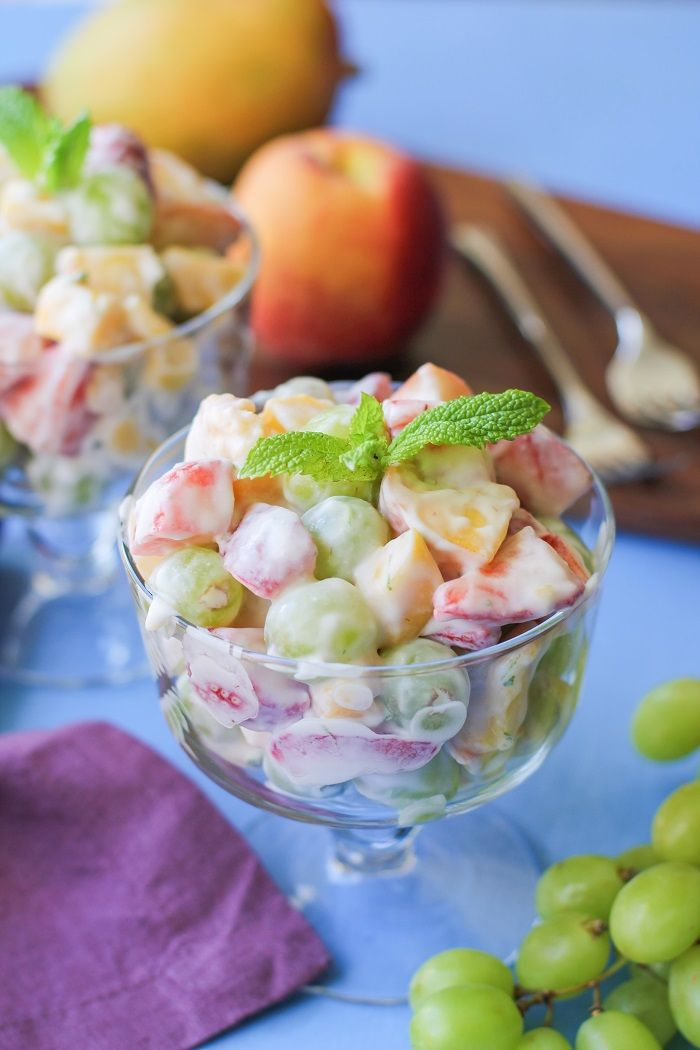 Funky fresh fruit salad with ripe seasonal fruit and naturally sweetened coconut whipped cream. The perfect fruit salad to bring to a picnic or barbecue. Oh yeah, that Memorial Day Weekend… H…