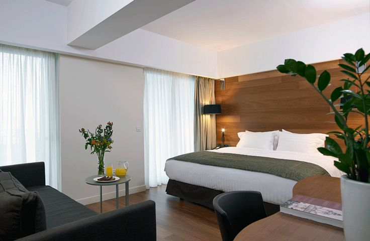 Superior Room with double bed equipped with premium COCO-MAT Eco bed systems with feather toppers