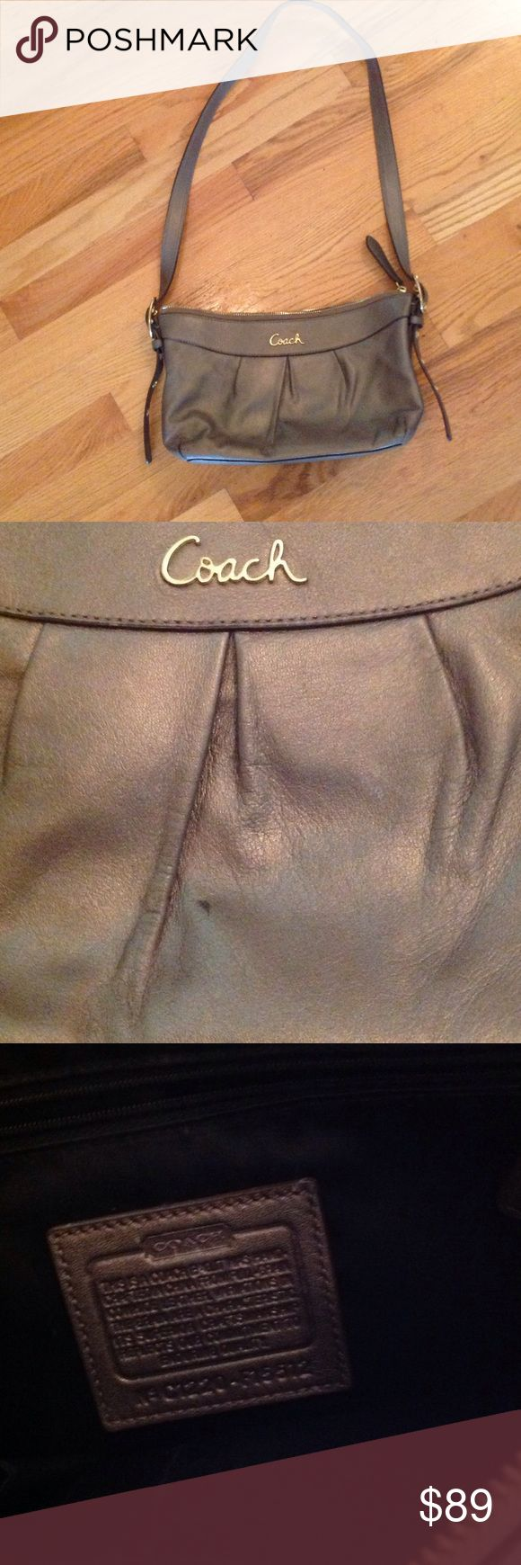 """Coach Leather Shoulder Bag Gorgeous Coach leather bag in a rich, metallic bronze color.  Adjustable shoulder straps feature gold hardware and grommets for an industrial, mixed media look.  Measures approx 12"""" x 5.5"""".  Very small mark on front, shown in 2nd photo.  Otherwise, in excellent pre-owned condition.  Check out my other listings to bundle and save:). Coach Bags Shoulder Bags"""