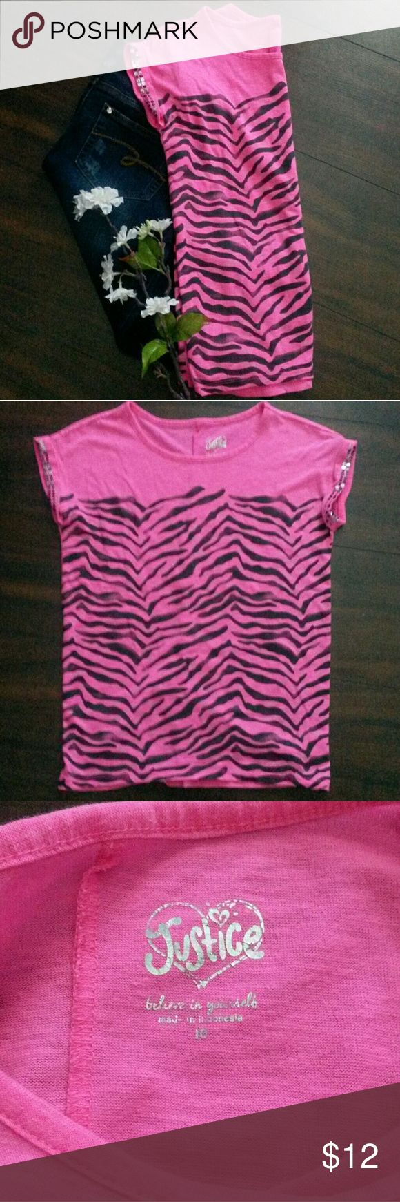 Girls pink shirt Feel feisty in this hot pink shirt with zebra stripes and sequined sleeves. EUC Justice Shirts & Tops Tees - Short Sleeve
