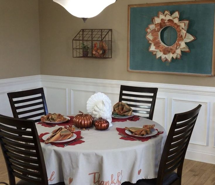 Next time you're at Target, buy a cheap tablecloth and copy this woman's gorgeous holiday decor idea!