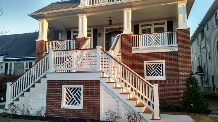 Custom fabricated Chippendale  Vinyl Railing with mahogany top rail. Ocean City Fence Co.