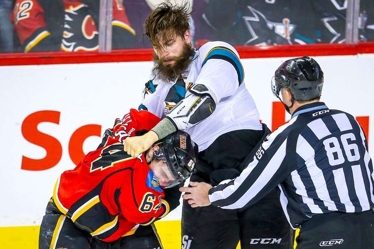 Fight night:    Calgary Flames right wing Garnet Hathaway, left, and San Jose Sharks defenseman Brent Burns fight during a game on March 7 in Calgary, Alberta.   -       © Sergei Belski/USA TODAY Sports
