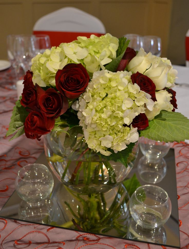 Red rose and white hydrangea floral centrepiece. Styled by Greenstone Events.