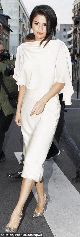 Selena Gomez goes braless in slinky backless gown during whirlwind European promo tour | Daily Mail Online