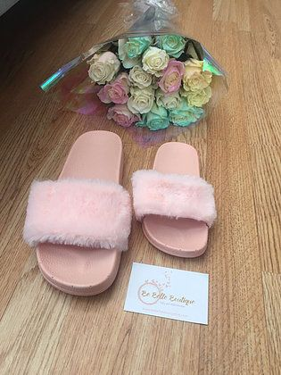 These fur sliders are so in at the moment! You can match your little one as these come in childrens' and adults' sizes.   #boutique #fashion#fashion