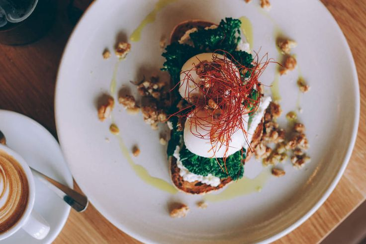 Poached eggs with broccolini and chilli 'hair' at Square
