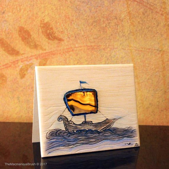 An #inkdrawing of a #ship on #balsawood #card with an #agate sail.