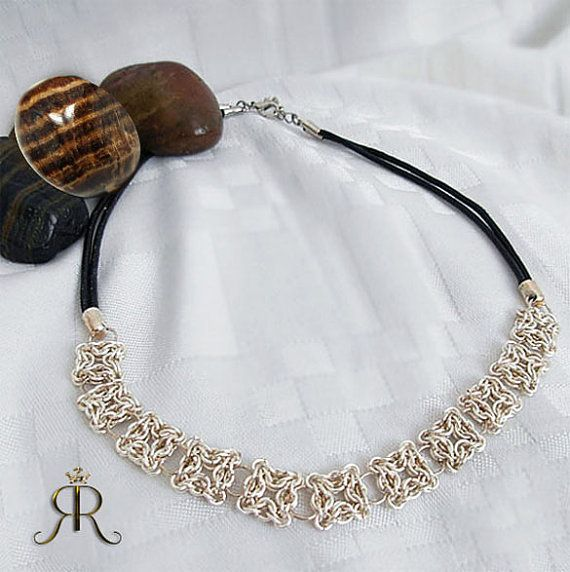 Black leather cord with hand-woven sterling silver focal section. $ 325