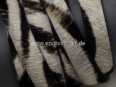 cow fur Ø10,0 x 2,0mm - zebra  Flat leather cord 10 mm x 2 mm - zebra fur. and genuine leather. Dyed cow fur to give this leather cord a zebra style look.