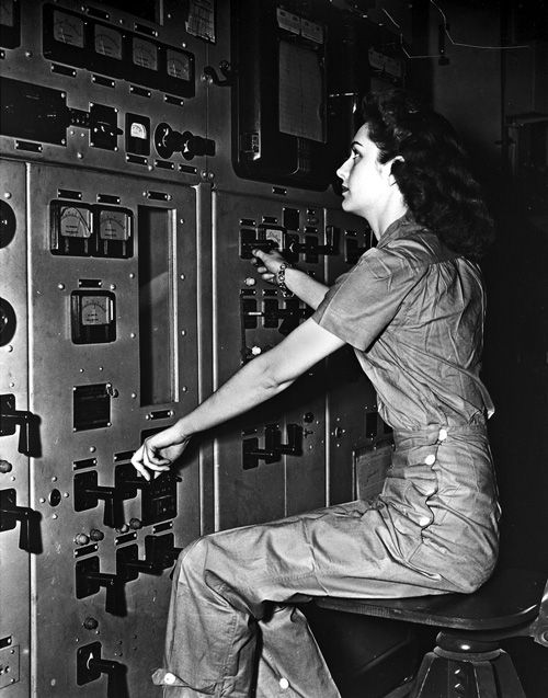 The Girls of Atomic City: The Untold Story of the Women Behind the Bomb Operator at a reactor control panel