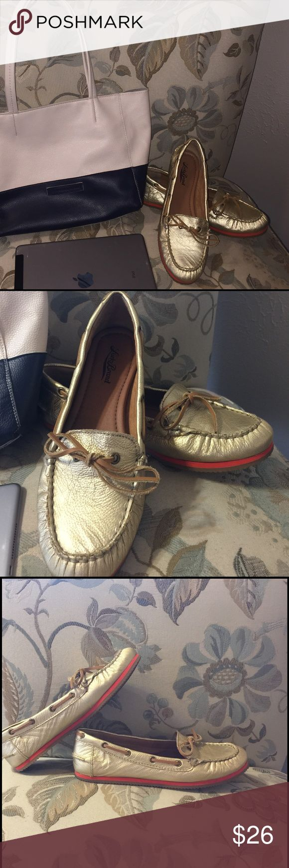 Lucky ladies boat shoes Lucky Brand size 8 gold loafers with coral stripe on sole...like new Lucky Brand Shoes Flats & Loafers